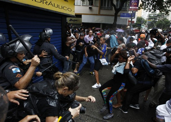 Riot police clash with demonstrators returning from Douglas da Silva's funeral.