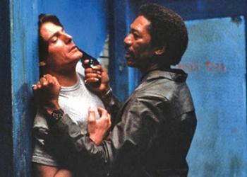 Freeman menaces Christopher Reeve in Street Smart.