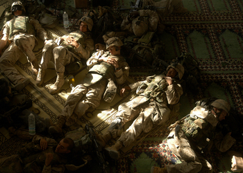 A break in the fighting in Falluja. Marines rest in the Grand Mosque. Lance Corporal Billy Miller is far right.